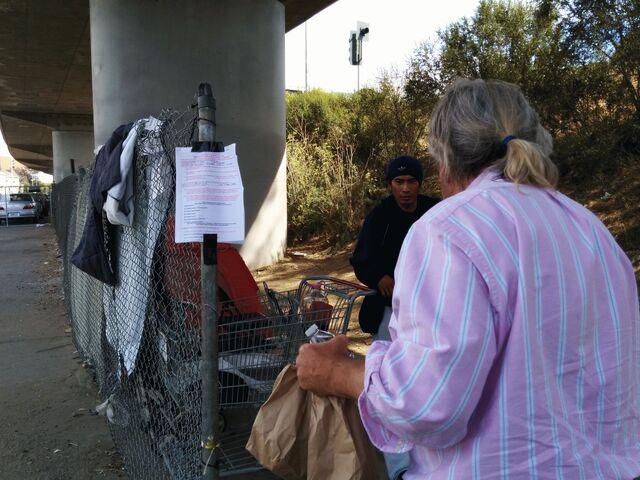 File:Andrew feeding under bridge.jpg