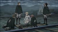 Hange's squad and Historia surround an unconscious Ymir