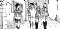 Hange and Mike escort Eren to the trial