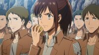 Sasha eating a potato