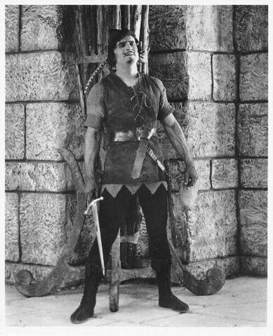 File:Fairbanks Robin Hood standing by wall w sword.jpg
