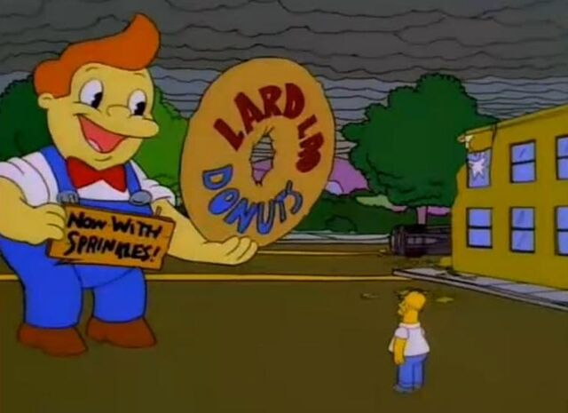 File:Lard Lad Tries To Distract Homer By Saying That His Donuts Now Have Sprinkles On Them.jpg