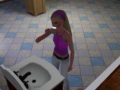 Sim brushing her teeth
