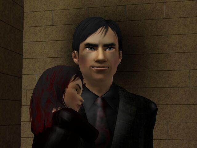 File:Wogan Hemlock holding his daughter.jpg