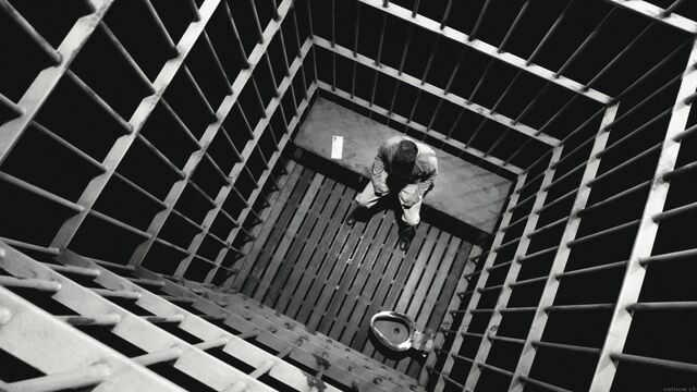 File:Alone in his cell.jpg