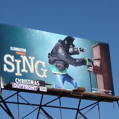Johnny appears on a billboard promoting <i>Sing</i> (location unknown)
