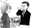 Fujimichi pushes glasses up