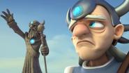 Beardless Eon looking at his statue