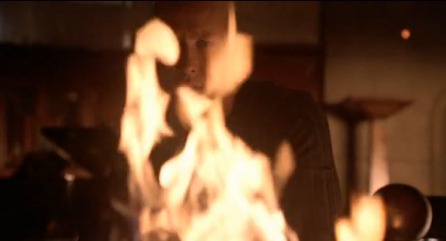 File:Lex burning a Lana's medical records.png