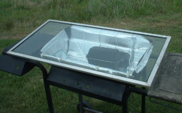 File:West's Solar Oven Cooking Cart in action closeups smaller.jpg