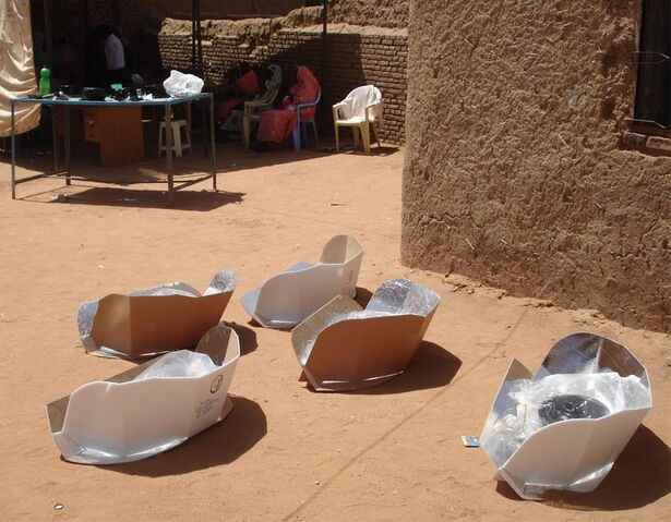 File:Women spend less time and energy foraging for firewood outside of IDP camps when they use solar CooKits.jpg .jpg