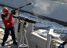 File:220px-US Navy 090107-N-3392P-065 Gunner's Mate Seaman James Clarke fires a shot line to the Military Sealift Command dry cargo-ammunition ship USNS Lewis and Clark (T-AKE 1).jpg