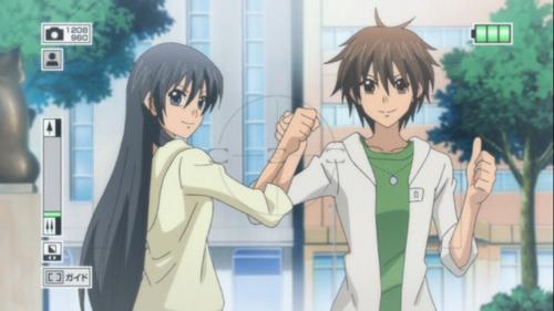 File:Hikari and Tadashi taking a picture...png