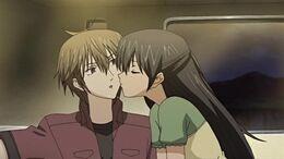 Hikari kisses Kei on the cheeks