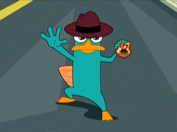 File:605px-Perry spy badge.png