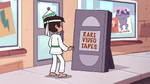 S2E4 Marco in front of Rare Video Tapes sign