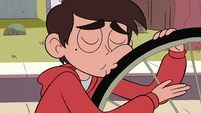 S2E5 Marco kissing his bike's tires