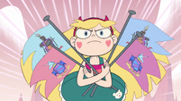 S2E15 Star Butterfly runs with armful of flags