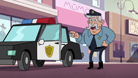 S2E24 Police officer pointing at Marco Diaz