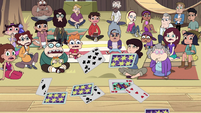 S2E29 Party guests looking at Preston's cards