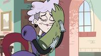 S2E36 Miss Heinous hugging Rasticore's arm