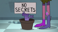 S2E1 Potted hand-plant with 'No Secrets' sign