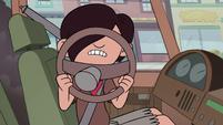 S2E5 Oskar holding a broken steering wheel