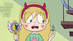 S2E23 Star Butterfly holding wand and Toffee's finger