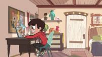 S2E19 Marco Diaz using his laptop