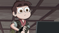 S2E31 Marco Diaz looking at his computer monitor