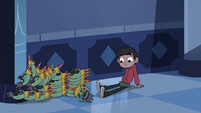 S3E6 Marco Diaz knocks over stacks of Ludo masks