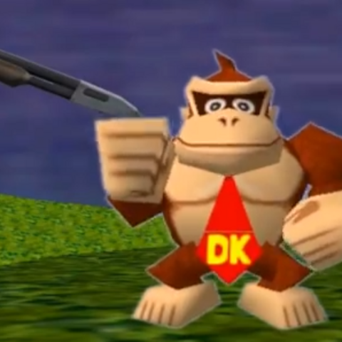 Donkey Kong wielding a rifle in order to protect his treasure.