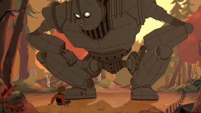 File:The Iron Giant crouches in front of Hogarth Hughes.jpg