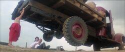 Superman - baby Kal-El lifts truck