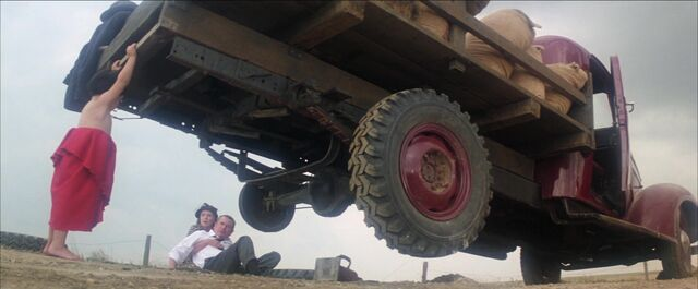 File:Superman - baby Kal-El lifts truck.jpg