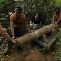 Drake at the first Immunity Challenge dragging their cannon through mud, leading against the other tribe.