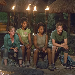 Tasha and her tribe at the 4th Tribal Council of the season.