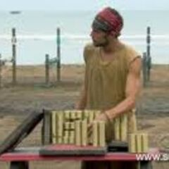 Benry solving the puzzle in <i>Survivor: Nicaragua</i>.
