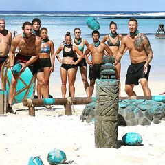 Henry and Luke smash idols with coconuts.