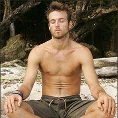 Aras practicing his yoga at camp.