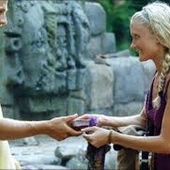 Krista giving Matt her bible.