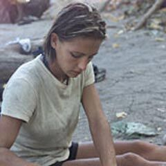 Sarah cooks at the Maraamu camp.