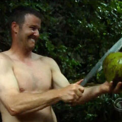 Jeff chopping a coconut.