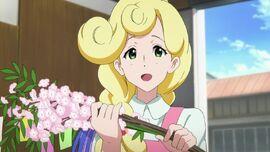 Kaoru holding flowers