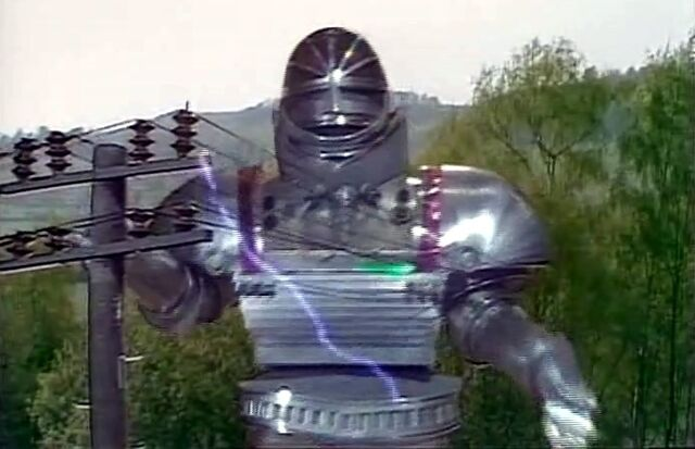 File:Robot in wires.jpg