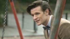 File:Eleventh Doctor on swings The Bells of Saint John A Prequel.jpg