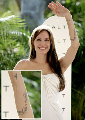 File:Angelina Jolie adds two new swirl tattoos to Roman numeral on left arm.jpg