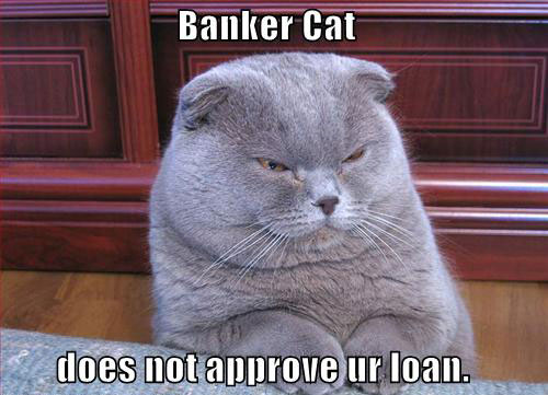 File:Banker-cat-does-not-approve-your-loan.jpg