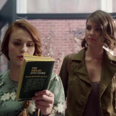 Lydia and Malia examining the book