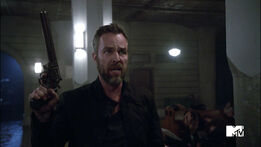 JR-Bourne-Chris-Argent-with-gun-Teen-Wolf-Season-6-Episode-10-Riders-on-the-Storm